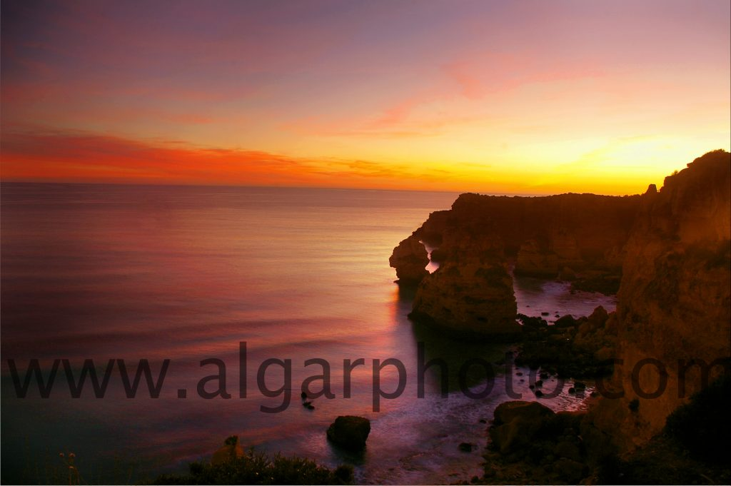 Sunset over Praia da Marinha in December